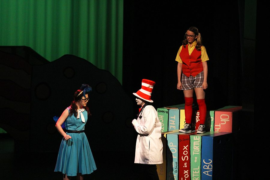 Annie Evans, Kaylee Rodriquez and Sarah McCaig act out a scene in the musical