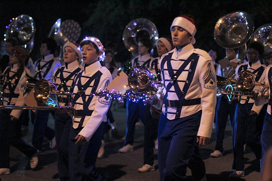 The band marches at the annual Christmas Parade. The upcoming Christmas concerts by band and choir are continued displays of Christmas cheer.