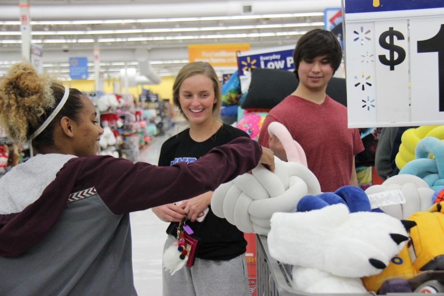 (From left to right) Senior Lauren Sumner, junior Braeleigh Flickenger and senior Logan Maynard shop for the angel gifts. NHS members went to Walmart and Target on November 30th.