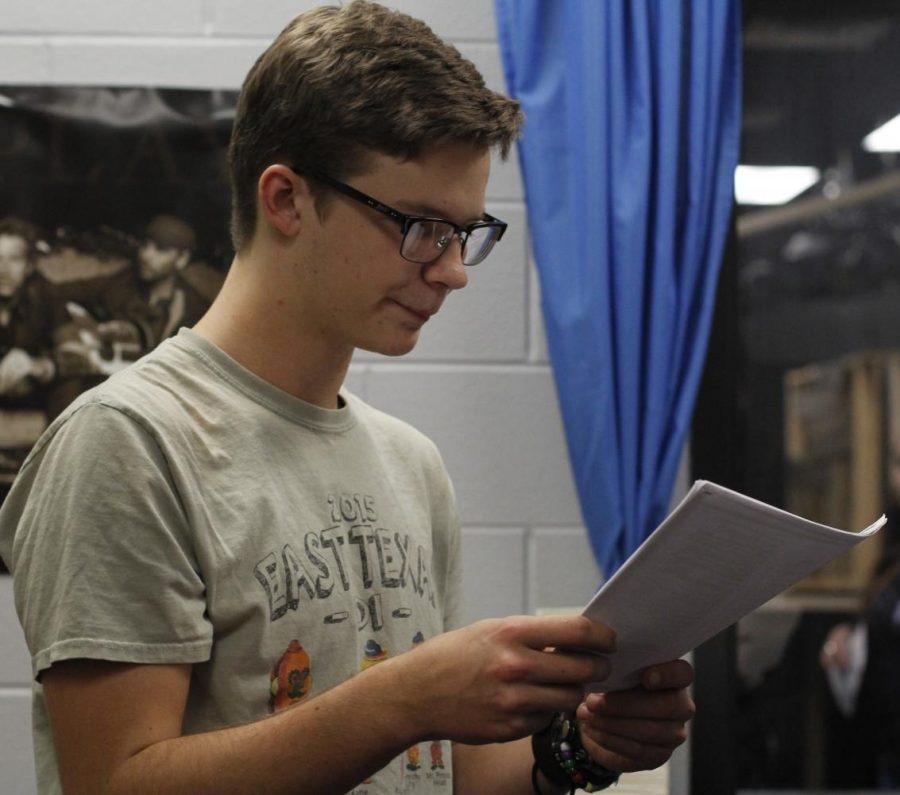 Giddeon Storkson reviews the script for his rehearsal.