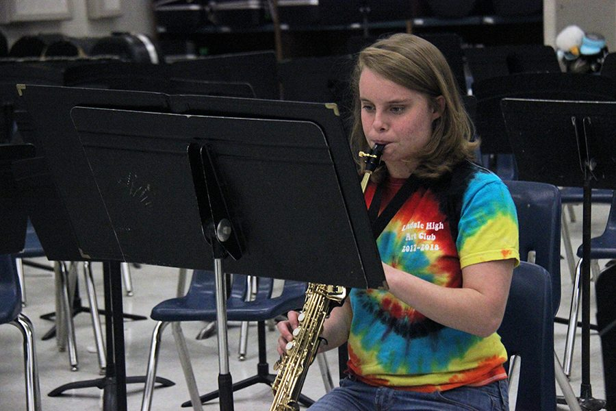 Senior Celeste Herman plays her saxophone. She is rehearsing for Solo and Ensemble.