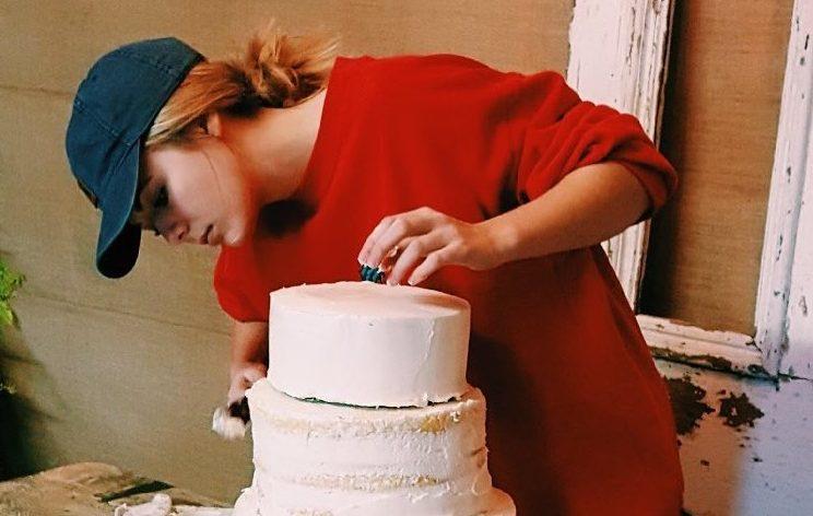 Junior Mattie Stricklin works on a cake for her new business.