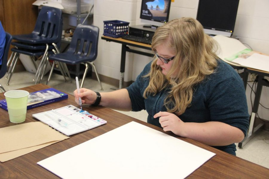 Danielle Harris begins painting for her VASE project. Harris will attend the VASE competition February 10.