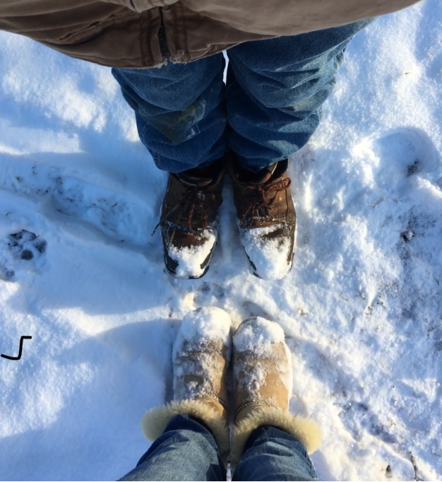 Junior Bailey Spencer and homeschooled junior Micah Innerarity capture the state of their boots after having fun in the snow. They took a walk in the city park on the snow day of January 16.