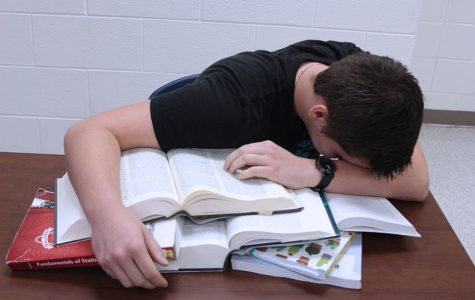 Senior Josh Martin exhausts himself working on homework. Eventually, he completed the work, though it was not of the quality he hoped.