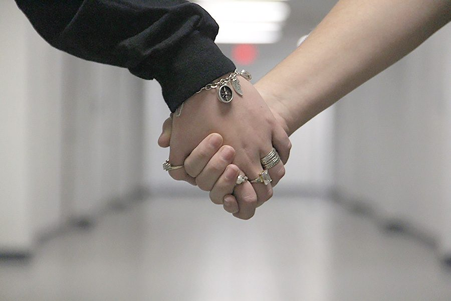 Students hold hands as a friendly gesture. Results from a Valentine's Day-related quiz revealed opinions about the holiday from the student body.