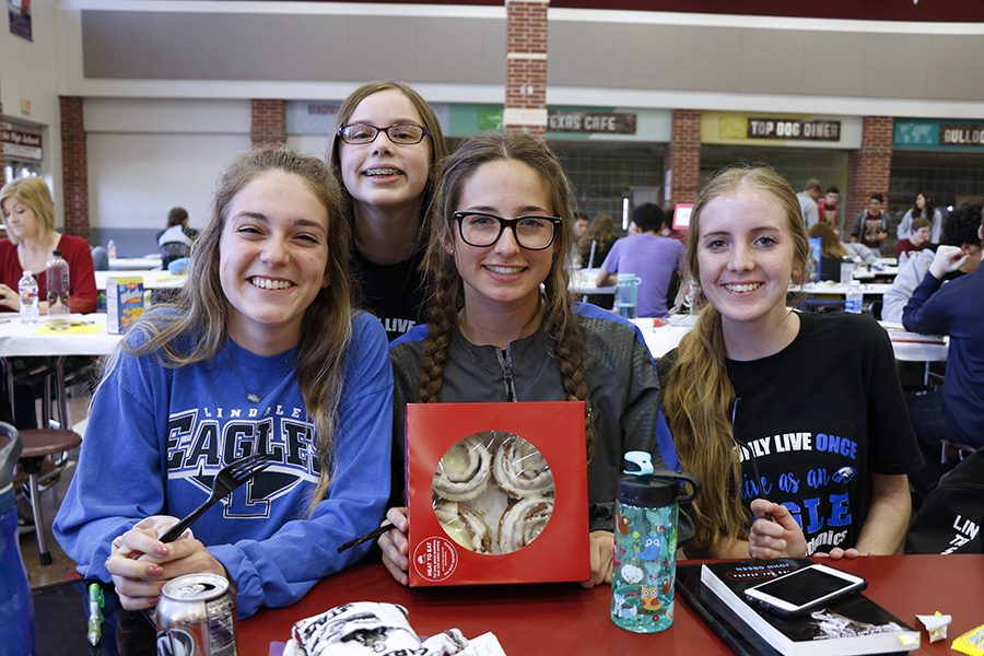 The Lindale journalism team poses with a gift from sponsor Neda Morrow. The team competed at Magnolia for regionals last season.