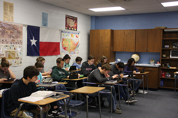 Sophomores in a World History class complete a project on their IPads. They will present in front of the class when the project is completed.