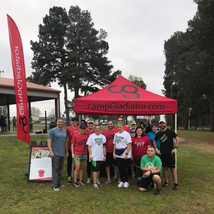 Camp Gladiator athletes stand after just finishing a locally sponsored trail race. Camp Gladiator offers both 5k and 10k runs to it's participants.