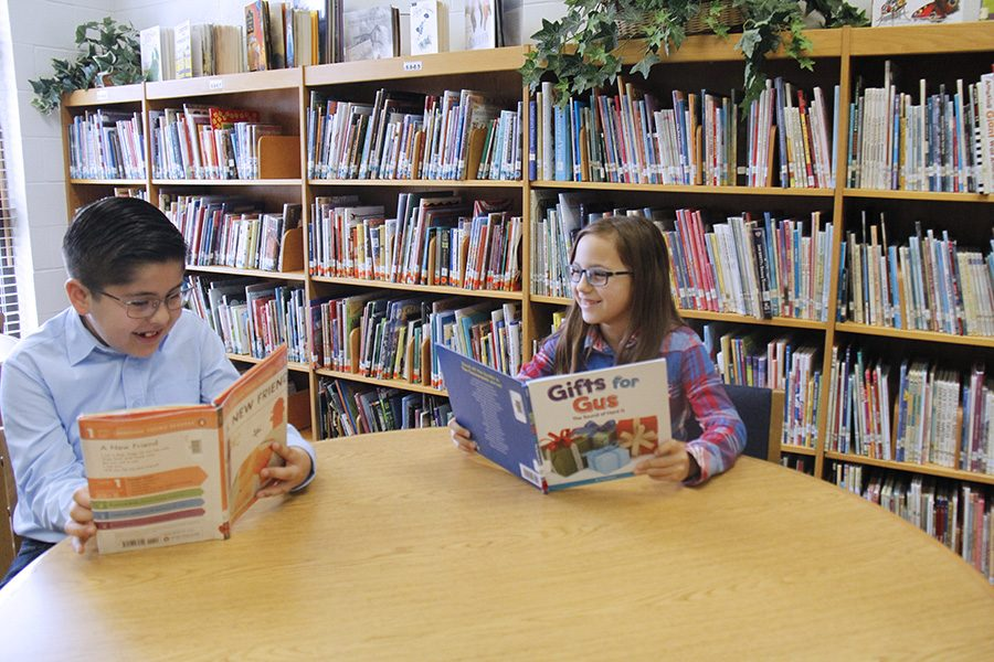 Third graders Ava Grogan and Jeremiah Hernandez celebrate the honor of being students of the month. The students were selected based on their character and well-roundedness as a student.