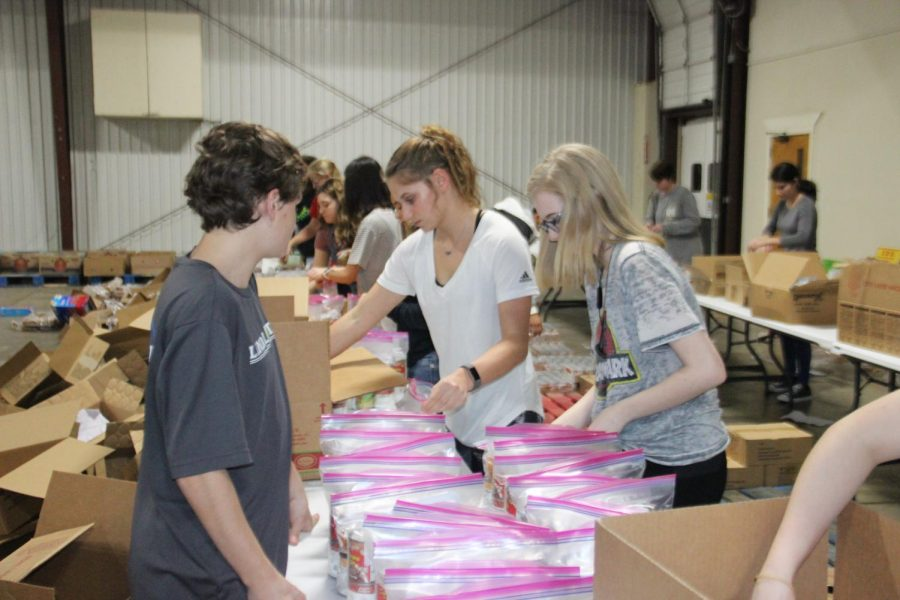 NHS student volunteers pack food bags at East Texas Food Bank. This organization has acted as a