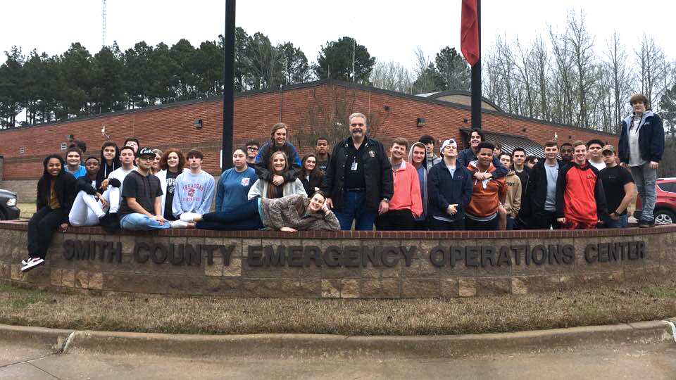 Johnson and his Law ll students pose in front of the emergency operations center. Students met with staff, toured facilities and discussed entry level jobs, salaries and benefits.