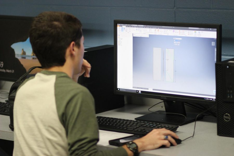 Senior Matthew Burns works on architectural design in Tonya Wheat's class. Burns designed an anti-UAV defense system for the SkillsUSA competition.