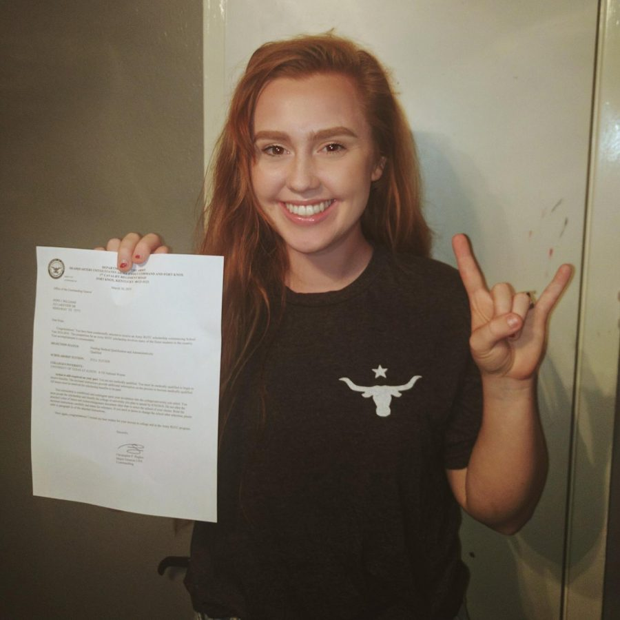 Hope Williams stands with her ROTC letter from U.T. Austin. She received a full ride to the college through ROTC.