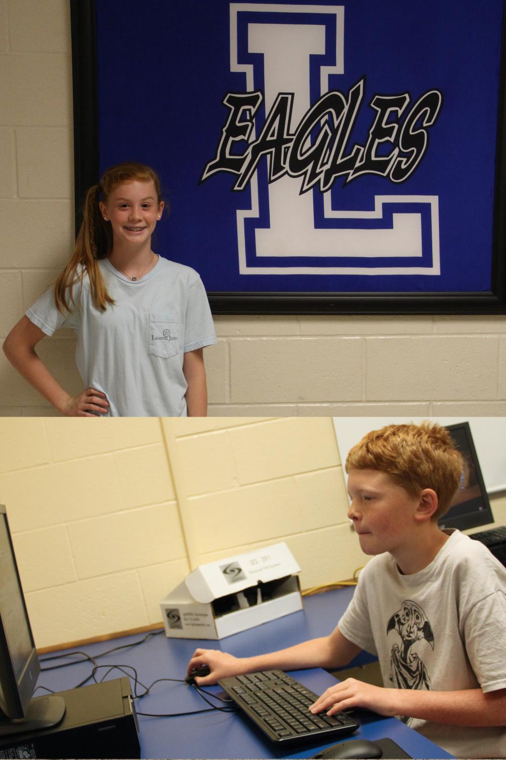 Sixth grader Landri Laing poses next to the Lindale ISD logo while fellow sixth grader Jaxson Buttram views pictures of the Periodic Table. They are the EJM sixth graders of the month.