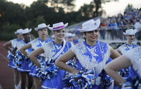 Junior Lizzy Graham walks in with her fellow Star Steppers. She is a member of both the band and the drill team.