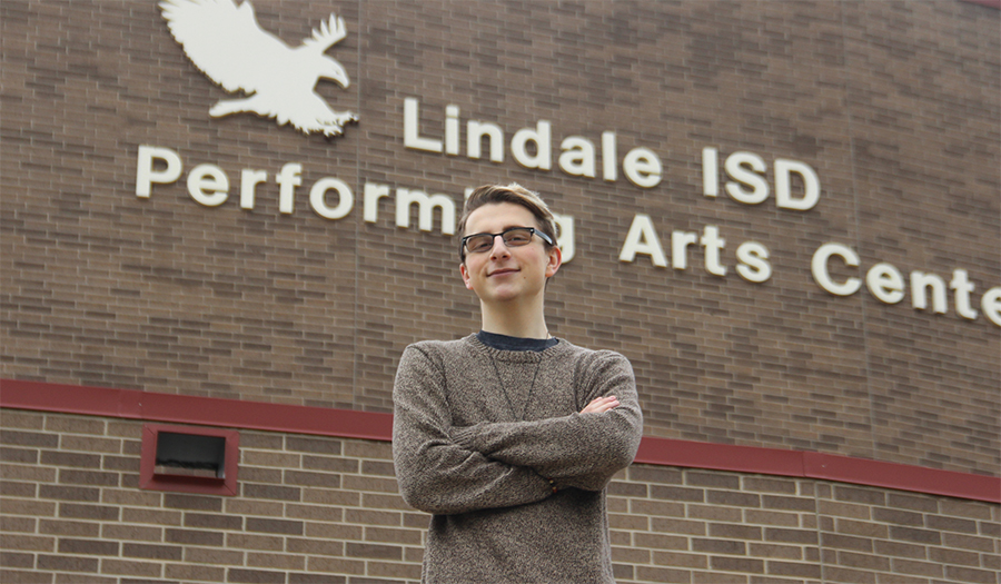 Senior Evan Bewersdorf poses outside the Performing Arts Center. Bewersdorf proposed that the building be named after a former Lindale educator.