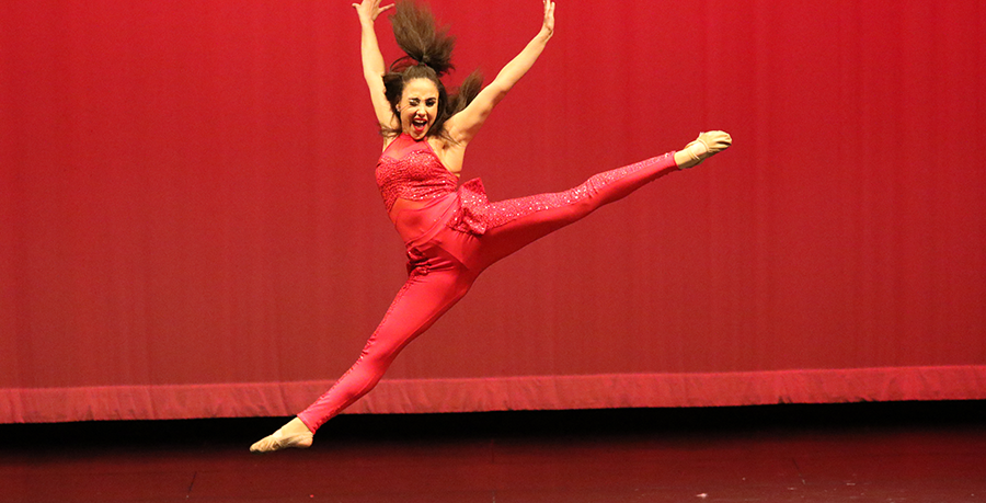 Senior Morgan Wishart performs a solo dance during the Spring Show. Wishart competed at MA Nationals with teammates Elizabeth Graham and Lainey Goodson.