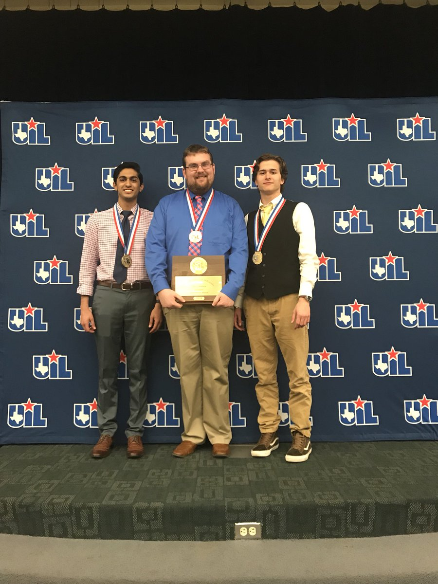 Ronak Desai (left) and Anthony Wyatt (right) stand with Rory McKenzie (middle) holding their award for the UIL competition.  The two are the first to win a state tournament in Lindale history.