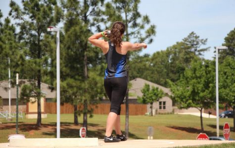 Senior  Summer Pruitt gets ready to throw shot-put at the Area meet. She along with 6 others will advance to the Regional competition