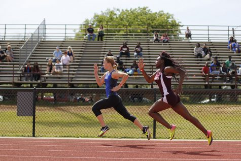 Track Competes at District