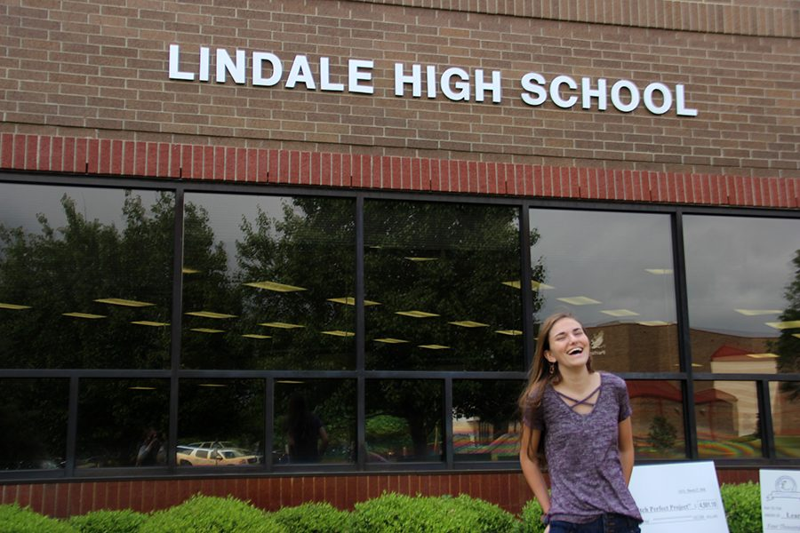 Kaitlyn Barrington shares a laugh in front of the high school. She will enter her senior year next semester.