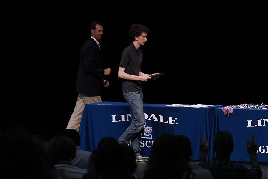 Sam Payne receives award and standing ovation at awards ceremony.  He was recognized for earning a perfect score on the ACT.