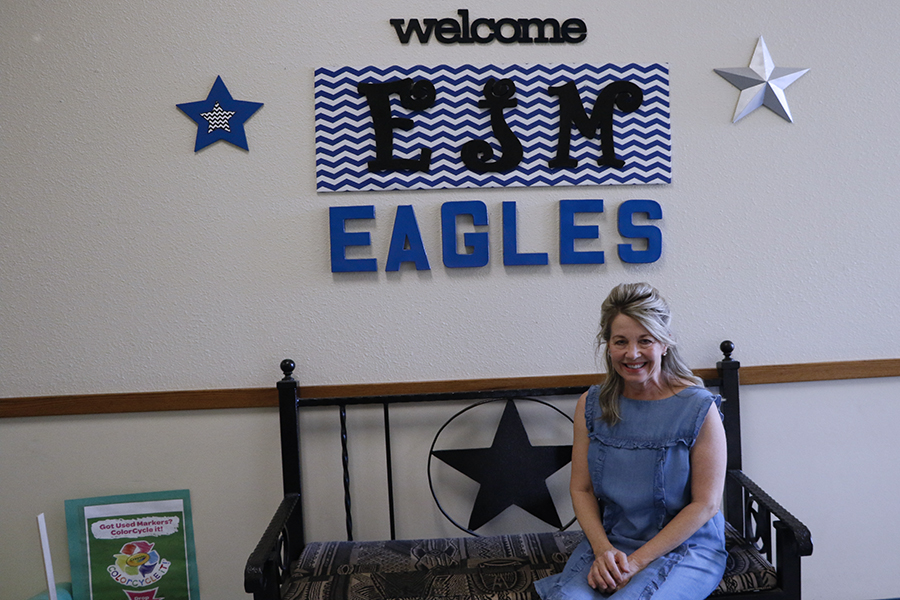 Fourth and fifth grade reading intervention teacher Gretchen Nees poses near a sign at E.J. Moss Intermediate. Nees is the teacher of the month.