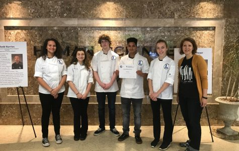 Lindale culinary students hold their first place certificate. The students won the competition over several other Texas schools.