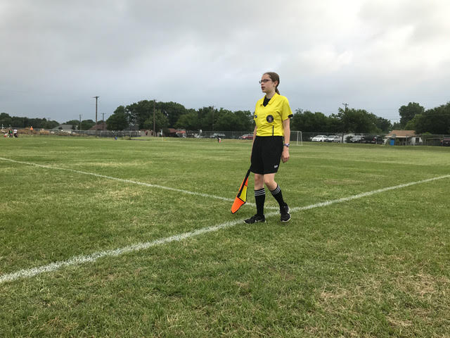 Sophomore Colleen Starkey referees a game at a tournament in Terrell. She has refereed for four seasons, and she has done two tournaments.