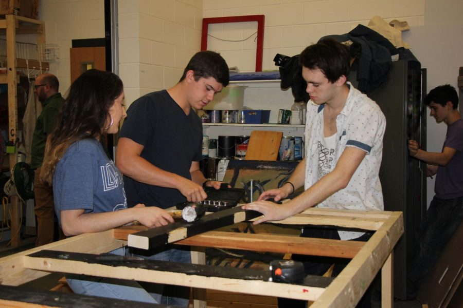 (From left to right) freshman Murphy Churchill, senior Matthew Henderson and junior Simon Young work on their project. The group decided to construct a car.