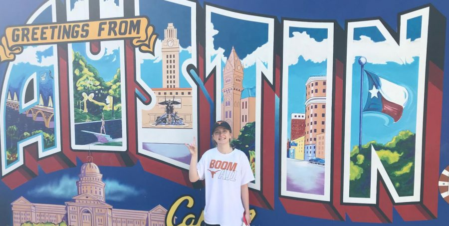 Undergraduate Sarah Huseth poses in front of the Austin mural to show off her college pride. She recently was got accepted as Assistant Editor to the UT Austin yearbook staff.