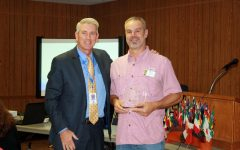 Surratt Presents Former Board President With a Rotary Award