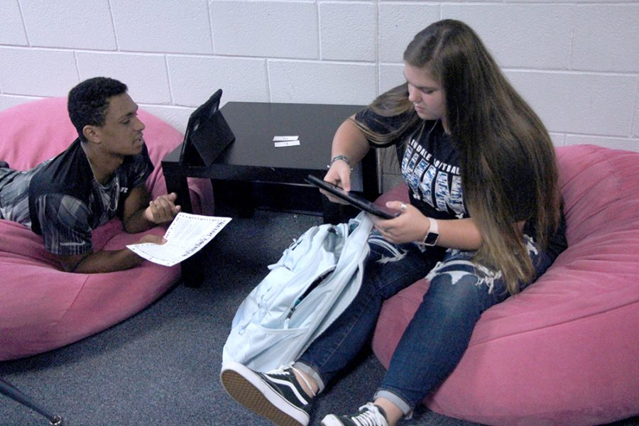 Juniors Christian Wood and Bree McHam relax on beanbags while working on a project in English teacher Kristin Quarles class. This is the second year Quarles has had this seating in her class, and many of her students regularly take advantage of the seating arrangements.