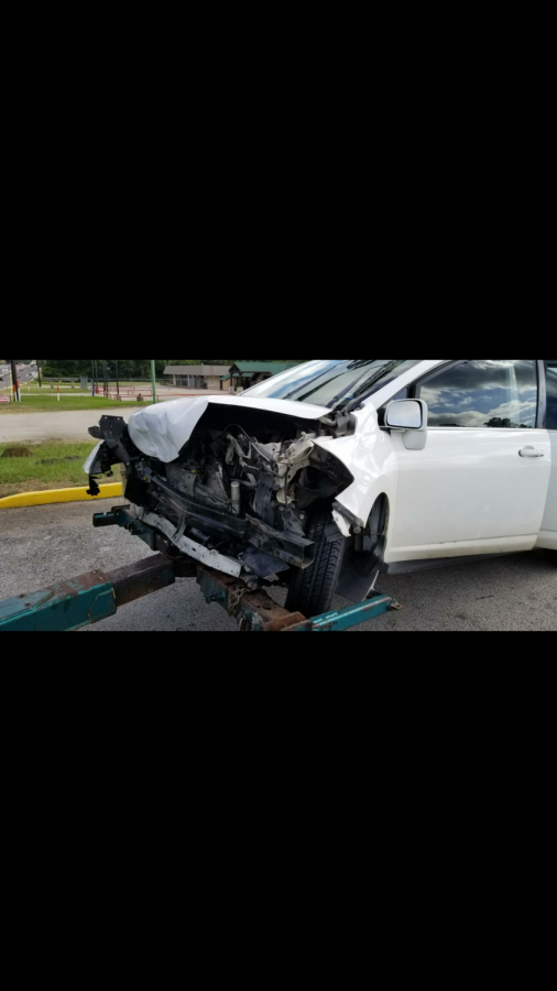 This is my car after the accident when it was being lifted by the towing truck.