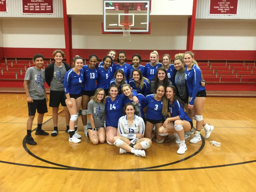 The+volleyball+team+poses+for+a+group+photo+following+the+team%E2%80%99s+bi-district+win+over+Lufkin.+They+will+play+Red+Oak+in+the+area+round+but+no+date+or+time+has+been+set+yet.+