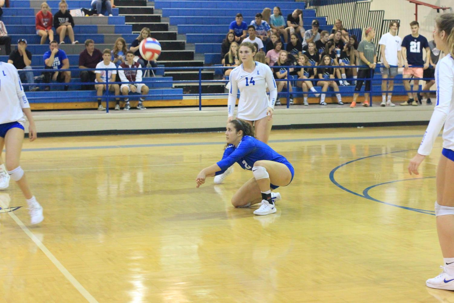 Senior Jennifer Moyer prepares to pass the incoming ball. Moyer has played volleyball since fifth grade and is the captain and lead defensive player for the Lady Eagles varsity volleyball team.