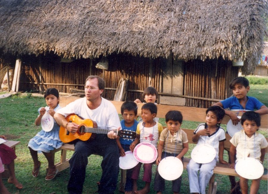 Mike+Maddox+plays+and+sings+for+children.+He+led+group+activities+for+the+children+in+Belize.+