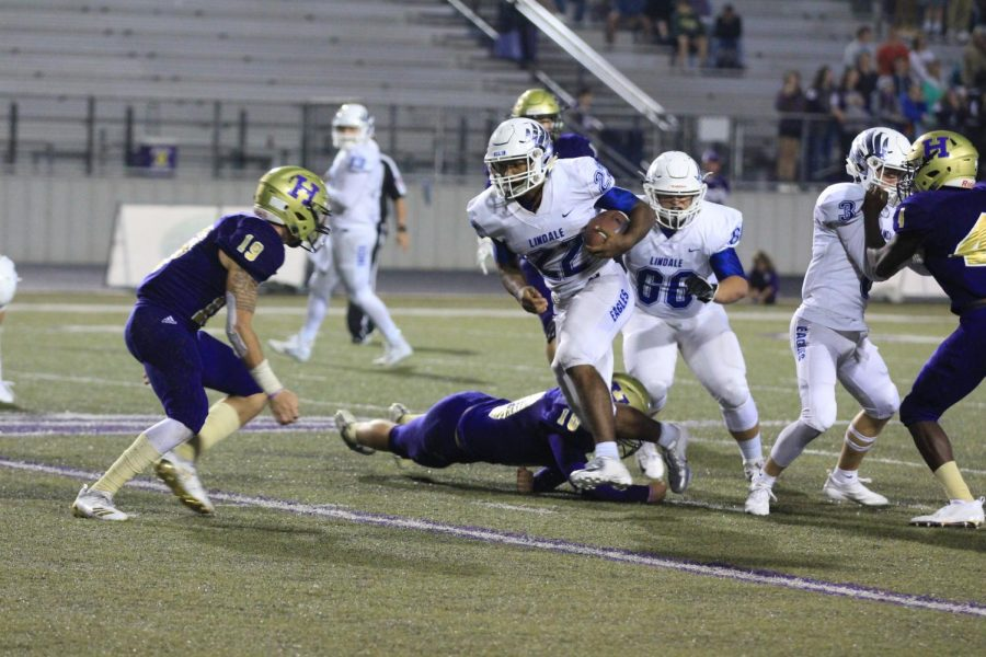 Sophomore Jordan Jenkins runs the ball toward the end zone. In this game, the Eagles beat Hallsville 42-28, and they are 3-1 so far in district, where they are tied with Whitehouse for second place.