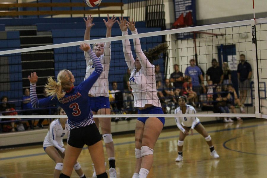 Two Lindale players jump up to block a spike. All three teams beat Gilmer in the non-district game.