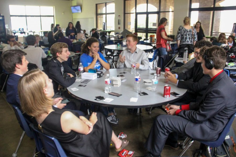 Speech and debate students enjoy a game of cards between rounds at the All Saints tournament. The team won third place sweepstakes at that tournament.