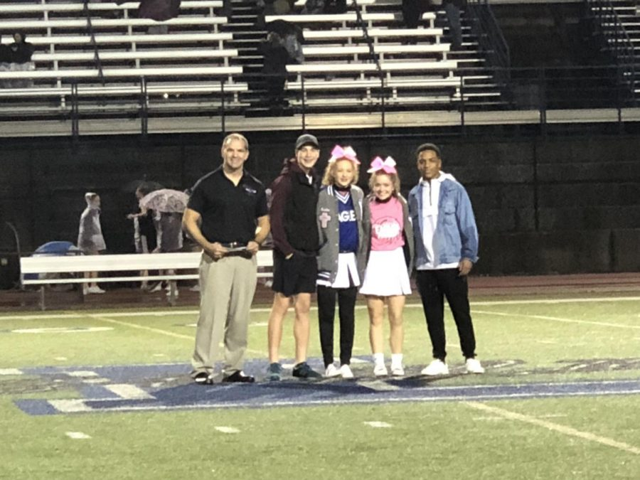 Senior Bobo Bobokins is honored at the Forney game for outstanding cheerness.