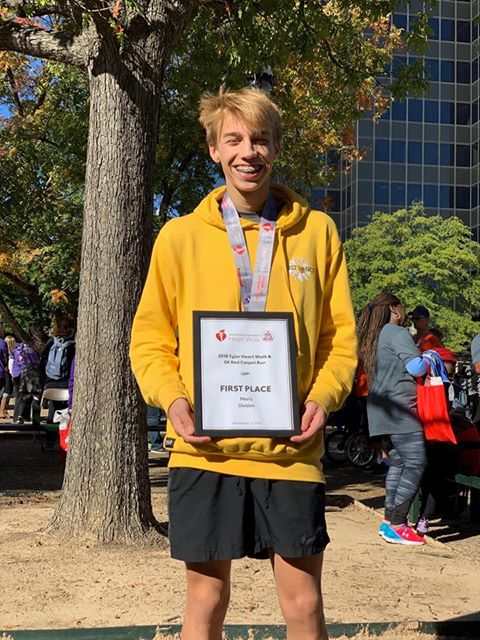 Sophomore Jacob Easom poses with his awards. Easom won first place in the Tyler Heart Walk & 5K Red Carpet Run.