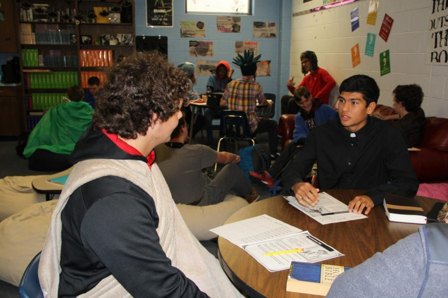 Two students engage in book dating. Rick Samaraweera (right) is giving a brief presentation of his book to another student.