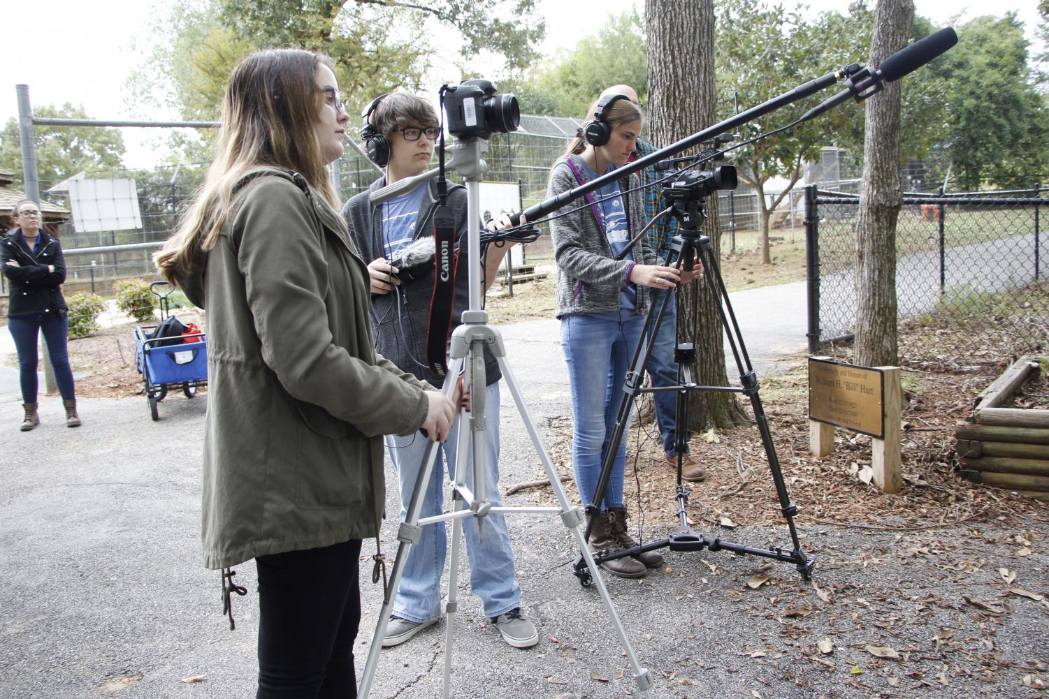 The audio visual team films documentary footage at Tiger Creek. The team will later create a finish product in the editing room.