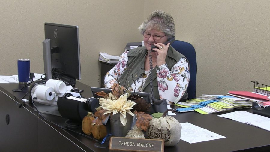 Teresa Malone answers telephone calls regarding financial situations. She is in charge of paying the bills for LISD.
