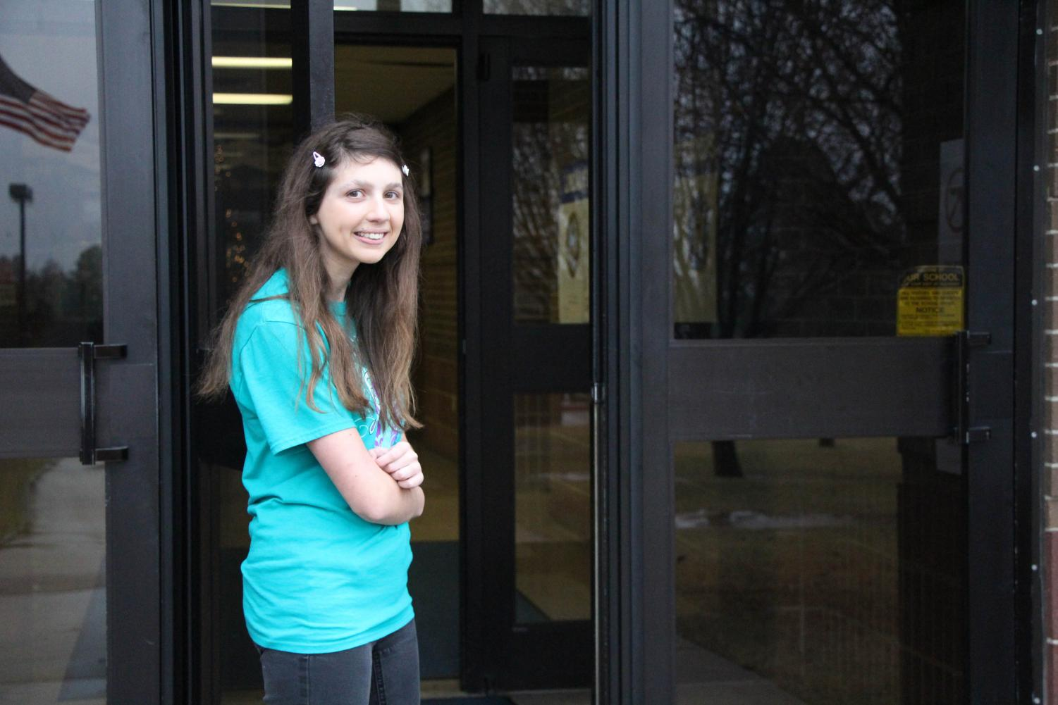 Gracie Tillary opens door for her fellow peers. She has been doing this every morning for the last few weeks.