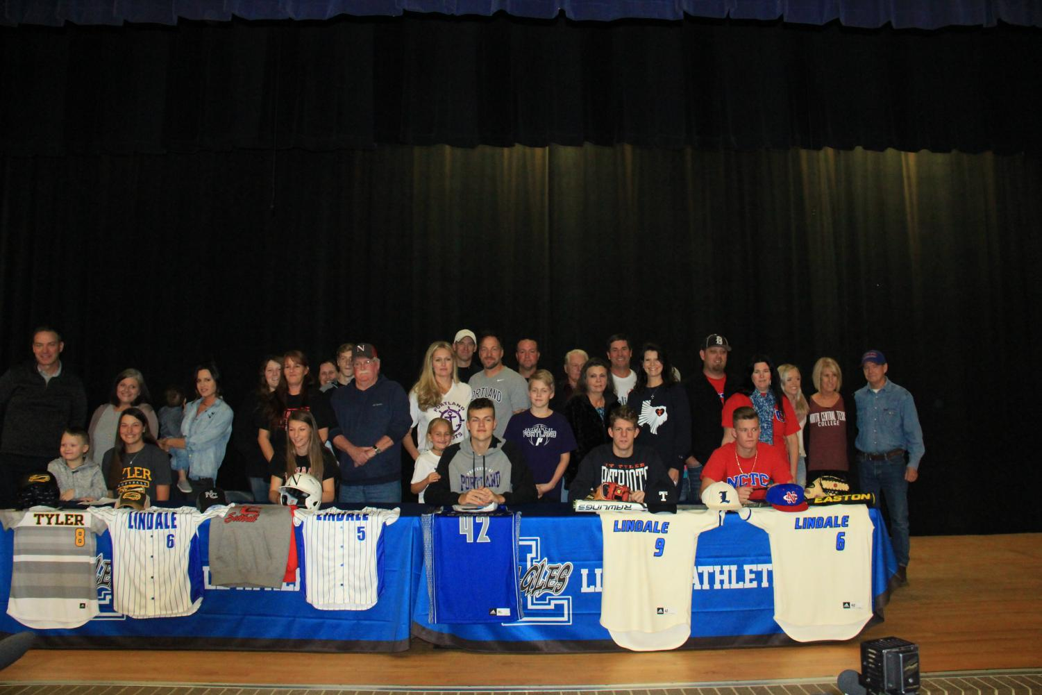 Athletes wait with their family after the signing conference. They have worked towards this day for at least the four years of high school.