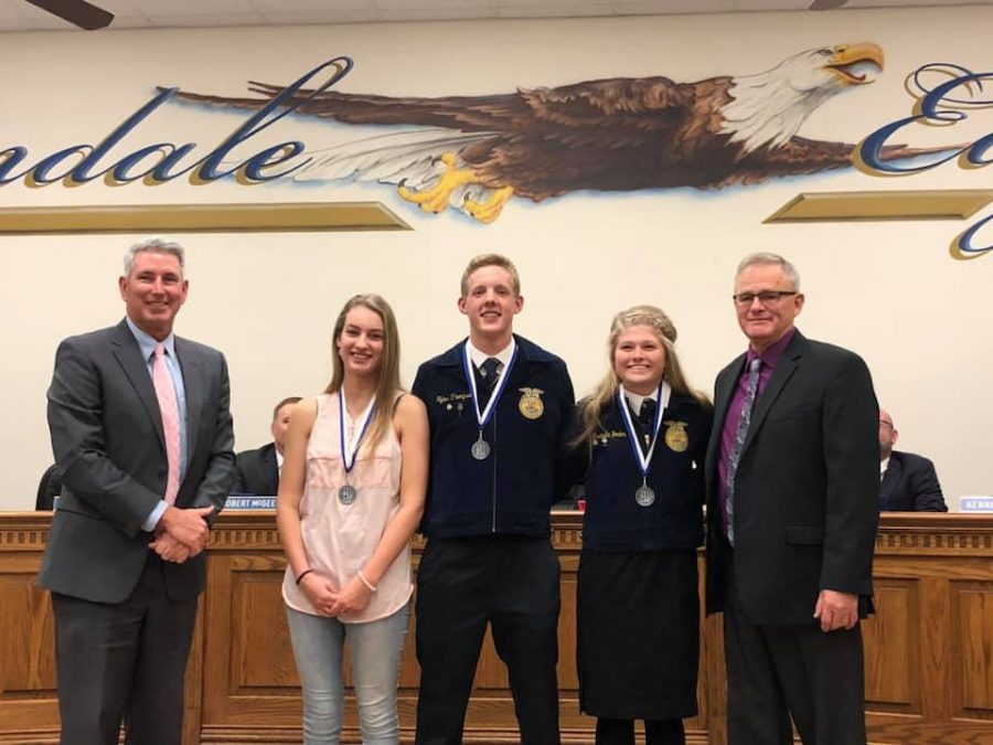 Jayden Gregory, Tyler Thompson and Bella Yoder were recognized in front of the school board for their achievements at the Mineola District Convention.