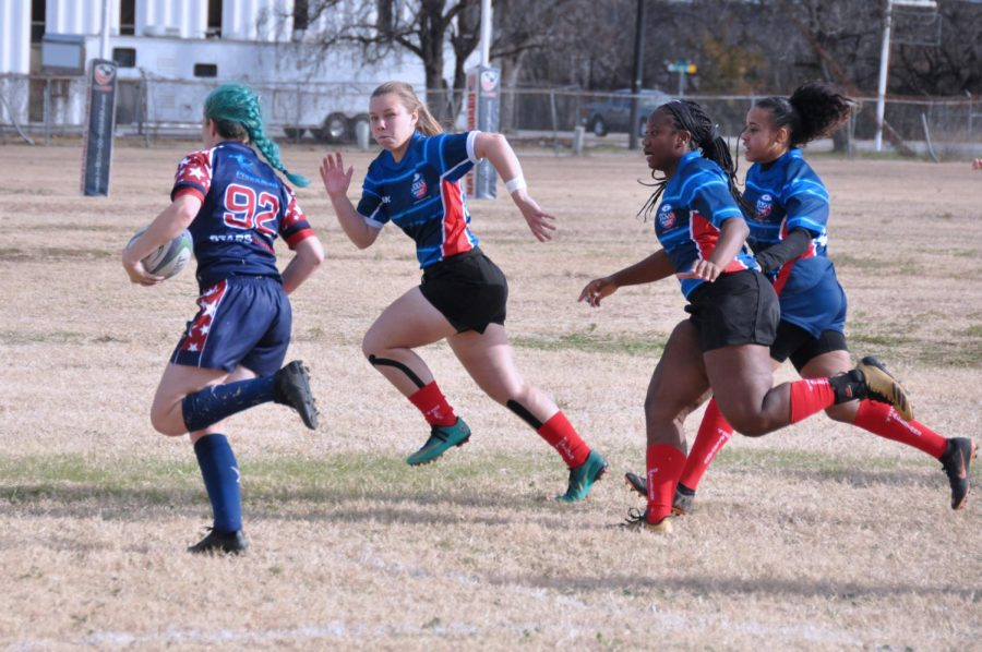 Lindale alumna Lynsey McKinney heads upfield with her All-Star teammates. She also recently attended a rugby camp in California.
